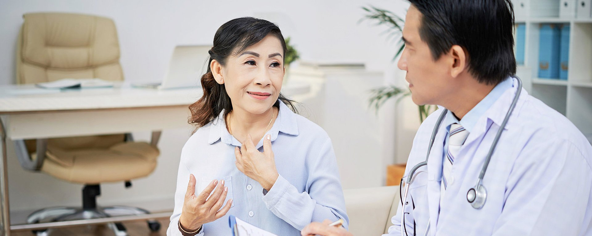 old woman and her physician having a serious conversation